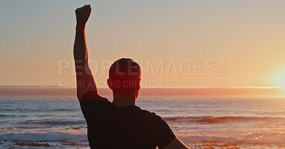 Buy stock photo Rearview shot of a mature man standing with his arms outstretched towards the sea while exercising along the promenade