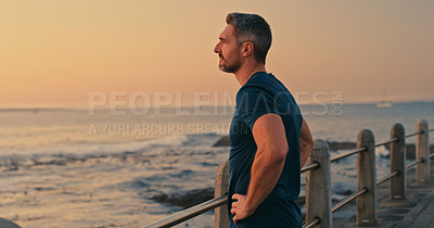 Buy stock photo Shot of a mature man looking thoughtful while admiring the view along the promenade