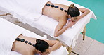 Hot stone massage therapy melts away tension